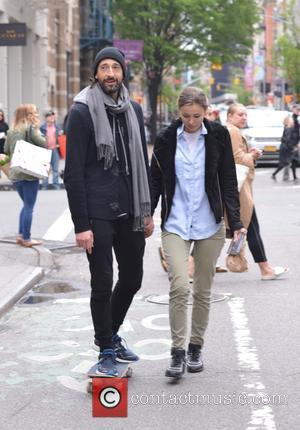 Adrien Brody , Lara Leito - Adrien Brody spotted skateboarding and holding hands with his girlfriend Lara Leito in Soho...