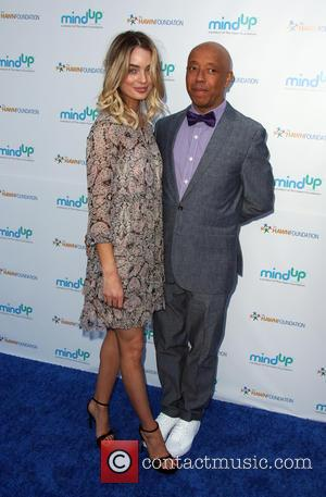 Lucy Mcintosh and Russell Simmons