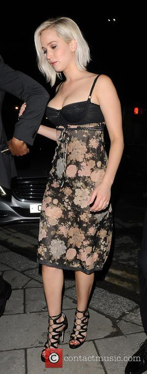 Jennifer Lawrence - Jennifer Lawrence arrives at a club in Mayfair with ample cleavage on show in tight bodice dress...