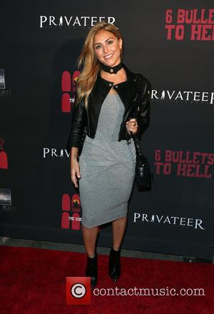 Cassie Scerbo - Launch of '6 Bullets to Hell' - Arrivals at Los Angeles - Los Angeles, California, United States...