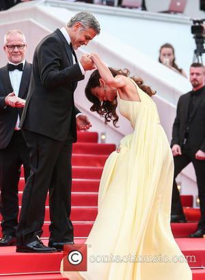 George Clooney , Amal Clooney - Red Carpet arrivals for the Money Monster screening at the 69th Cannes Film Festival...