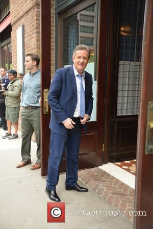 Piers Morgan - Piers Morgan smiles for photographers outside The Greenwich Hotel - Manhattan, New York, United States - Friday...
