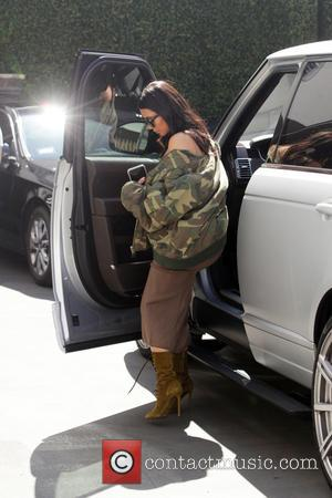 Kim Kardashian - Kim Kardashian chats on her mobile phone as she leaves Epione Skin Clinic in Beverly Hills -...