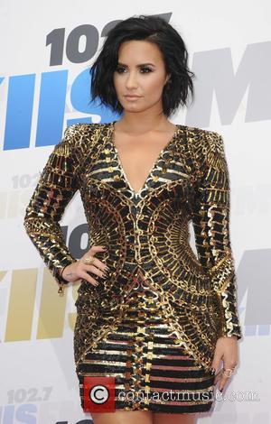 Demi Lovato Supports Musicares Charity Campaign
