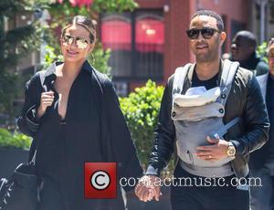 Chrissy Teigen, John Legend , Luna Simone Stephens - Chrissy Teigen and John Legend enjoying a stroll with their baby...