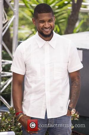 Usher Raymond IV - Actors  attends a photocall for