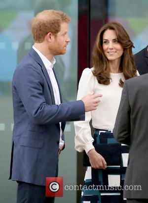 Catherine Duchess Of Cambridge and Prince Harry