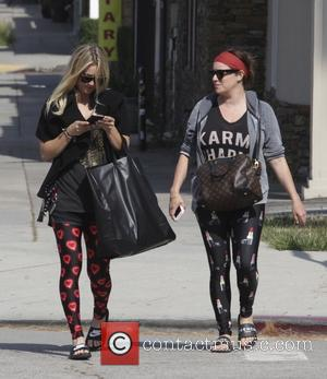 Kaley Cuoco - Kaley Cuoco and a friend go to their yoga class in Sherman Oaks - Los Angeles, California,...