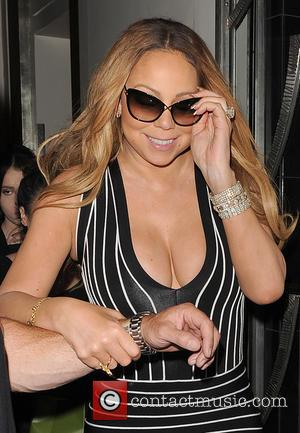 Mariah Carey - Mariah Carey leaves Claridges hotel, amid chaotic scenes. Two burly minders escorted her to her car, while...
