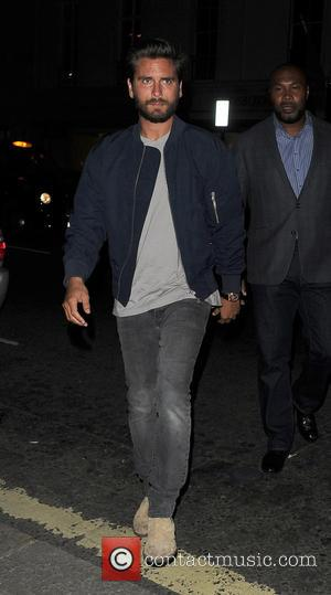 Scott Disick - Scott Disick leaving Hakkasan restaurant with an attractive female companion following him shortly after, to avoid being...
