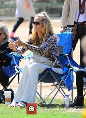 Heidi Klum - Heidi Klum takes her children to a soccer game in Brentwood and bumps into actor Mark Wahlberg....