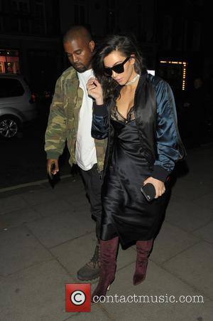 Kim Kardashian , Kanye West - Kim Kardashian and Kanye West return to their hotel in London - London, United...