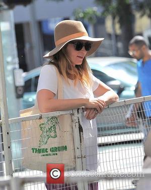 Emily Blunt - A Pregnant Emily Blunt and husband John Krasinski take their daughter, Hazel, to the Farmers Market -...