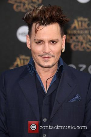Johnny Depp Thanks Fans For Sticking By Him During Tough Year At Awards Show