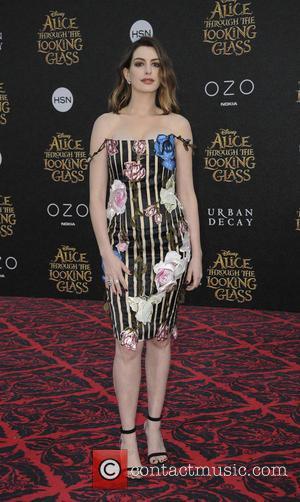 Anne Hathaway Tears Into James Corden In Rap Battle