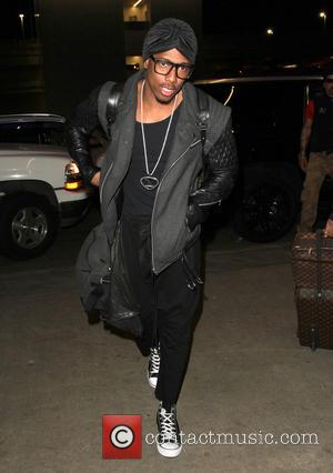 Nick Cannon - Nick Cannon arrives at Los Angeles International (LAX) Airport - Los Angeles, California, United States - Wednesday...