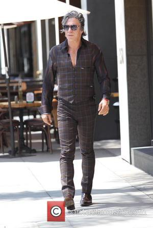 Mickey Rourke - Mickey Rourke leaving Cafe Roma in Beverly Hills - Los Angeles, California, United States - Friday 27th...
