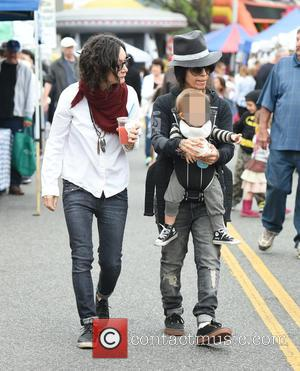 Sara Gilbert, Linda Perry and Rhodes Perry