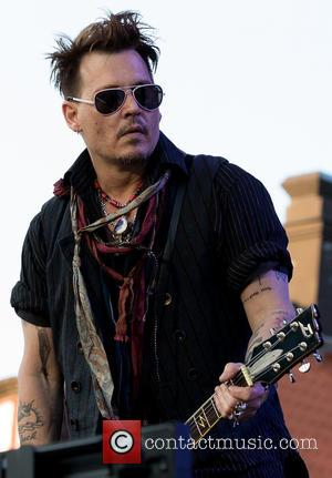 Johnny Depp Goes Sightseeing Amid Divorce Drama