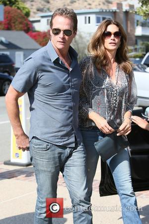 Cindy Crawford , Rande Gerber - Cindy Crawford and Rande Gerber arriving at Joel Silver Memorial Day party as everyone...