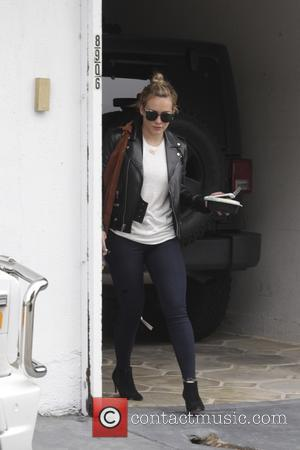 Hilary Duff - Hilary Duff leaving the gym in Beverly Hills wearing a leather biker jacket and sunglasses - Beverly...