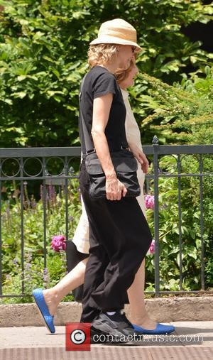 Meg Ryan - Meg Ryan exposes her midriff and 'life is short' tattoo while out in Soho - Manhattan, New...