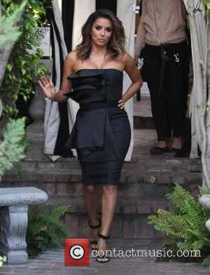 Eva Longoria - Newly married Eva Longoria shows off her wedding ring as she leaves Ken Paves salon in Beverly...