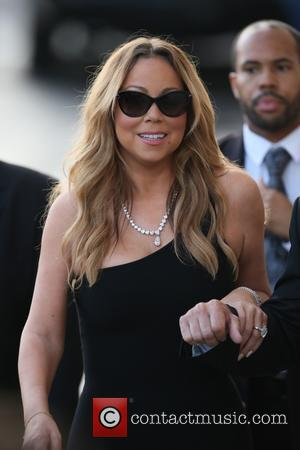 Mariah Carey Blindfolds John Legend On Stage