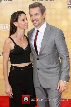 Tharita Cesaroni and Dermot Mulroney