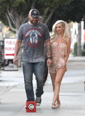 Randy Couture , Mindy Robinson - Randy Couture and girlfriend Mindy Robinson appear in good spirits while out and about...