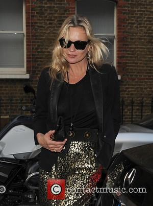 Kate Moss - Kate Moss arrives at a exhibition in Mayfair. Kate's trousers appeared to have ripped at the seam,...