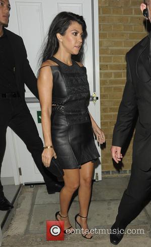 Kourtney Kardashian - Kourtney Kardashian and Lindsay Lohan enjoy a night out at Lou Lou's private members club in Mayfair...