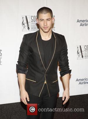 Nick Jonas Takes Style Tips From Elvis Costello
