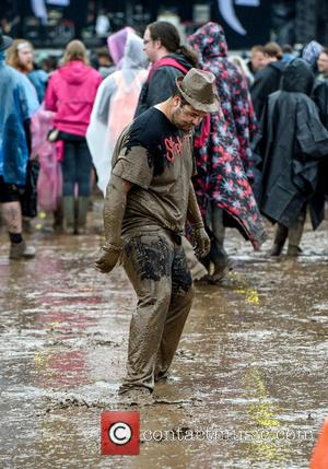 Atmosphere - Download Festival revellers in the mud at Donington Park, Download Festival - Donington, United Kingdom - Sunday 12th...