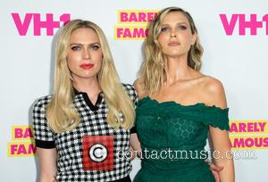 Actresses Erin Foster (l) and Sara Foster