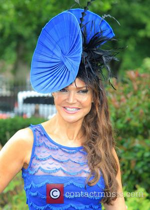 Lizzie Cundy - Spectators begin to arrive at a very wet and rainy Ascot Racecourse for day 1 of Royal...