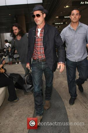 Brad Pitt - Brad Pitt arrives at Los Angeles International (LAX) Airport - Los Angeles, California, United States - Wednesday...