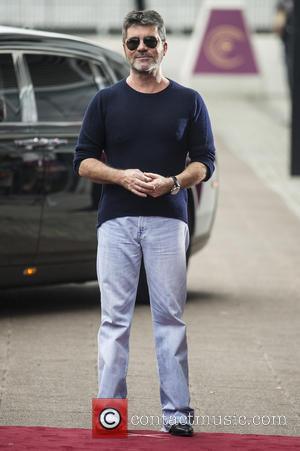 Simon Cowell 'Desperate' To Land Spice Girls' Anniversary Album
