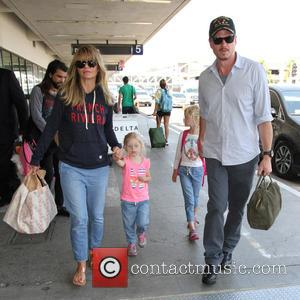 Rebecca Gayheart, Billie Beatrice Dane , Georgia Dane - Eric Dane arrives at Los Angeles International Airport with his family...
