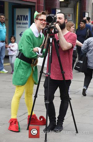 Tom Fletcher - McFly's Tom Fletcher, dressed as an Elf, filming in Oxford Street, London at Oxford Street - London,...