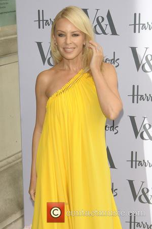 Kylie Minogue draped in a beautiful yellow full length dress arriving at the Victoria and Albert Museum Summer Party -...