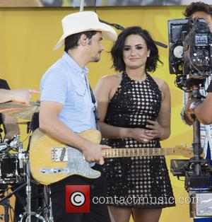Brad Paisley , Demi Lovato - Brad Paisley and Demi Lovato appear on stage together and delight fans in Central...