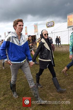 Poppy Delevingne holding hands with her husband James Cook backstage at the 2016 Glastonbury Festival. Celebrity Sightings at Glastonbury Festival...