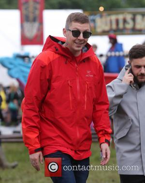 Professor Green was one of the many celebrities seen wandering around backstage on the first day of Glastonbury Festival 2016...
