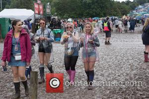 As the mud deepened, spirits were still high at Glastonbury Festival 2016. Wellies, shorts and fancy dress are all part...