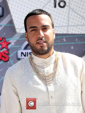 French Montana in a dapper white suit stopping for photographers on the red carpet at the 2016 BET Awards held...
