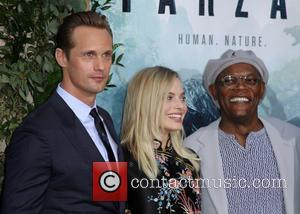Actor Alexander Skarsgard poses alone and with his co-stars Margot Robbie and Samuel L. Jackson at the premiere of 'The...