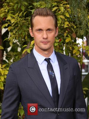 Actor Alexander Skarsgard poses alone and with his lead co-star Margot Robbie at the premiere of 'The Legend Of Tarzan'...