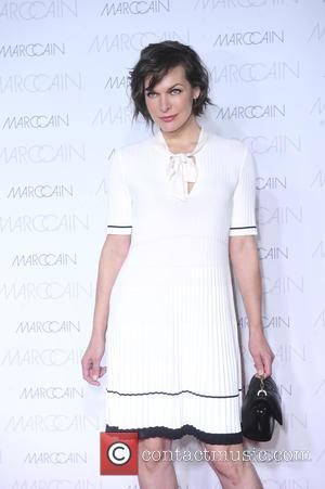 Milla Jovovich is seen at Marc Cain's designer runway show at the Berlin Spring/Summer Mercedes Benz Fashion Week held at...