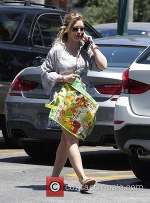 Hilary Duff goes shopping at Studio City wearing denim cutoff shorts in preparation for 4th of July celebrations. Los Angeles,...
